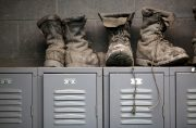 Coal mining boots are shown above miners' lockers before the start of an afternoon shift at a coal mine near Gilbert, West Virginia May 22, 2014. REUTERS/Robert Galbraith/File Photo GLOBAL BUSINESS WEEK AHEAD PACKAGE - SEARCH 'BUSINESS WEEK AHEAD MAY 2' FOR ALL IMAGES - RTX2CDIO