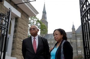 Joe Stewart and Patricia Bayonne-Johnson, both descendants of people sold as slaves by Georgetown University, arrive to hear about moves aimed at acknowledging and encouraging dialogue about the Jesuit-run university's ties to slavery in Washington, September 1, 2016. REUTERS/Joshua Roberts - RTX2NU22