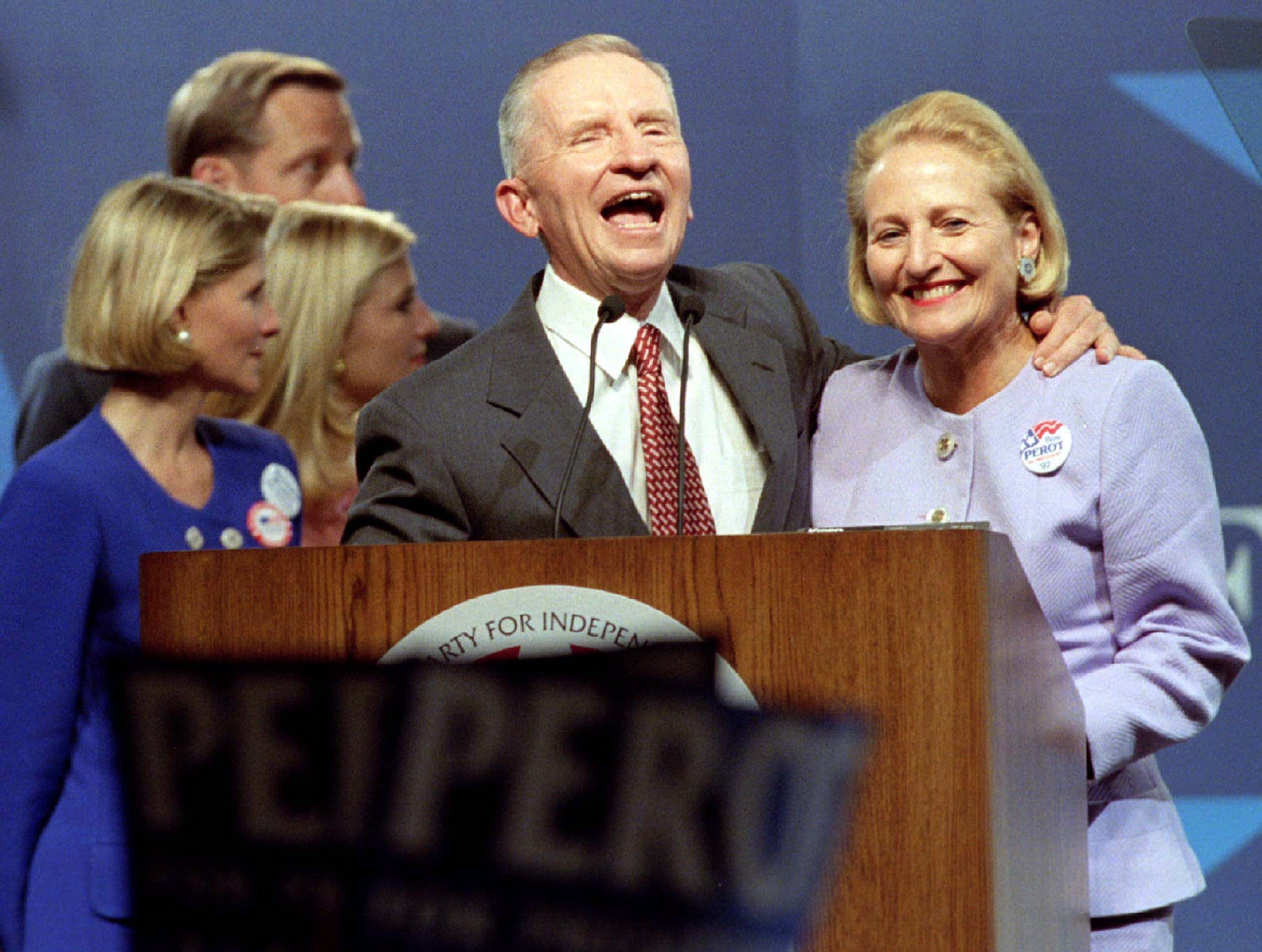 Reform Party presidential nominee Ross Perot is joined on stage by wife Margot (R) and other family members after speaking at the party's national convention in Valley Forge, Pennsylvania August 18. Perot, launching his second presidential campaign said he would not bankroll his campaign from his personal fortune as in 1992, but would rely on federal funding and private contributions. - RTXGKIC
