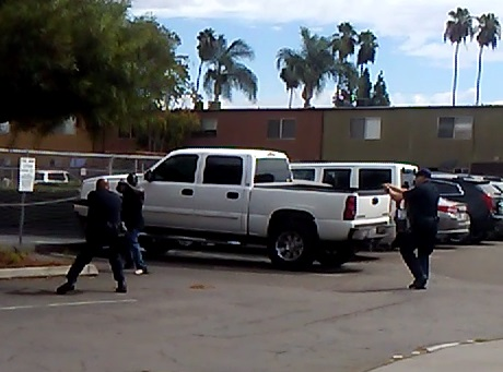 Police in El Cajon, California, released this still from a bystander's cell phone footage shortly after the fatal shooting of an unarmed black man Tuesday. It shows the man holding up an unidentified object toward an officer. Police said it was not a weapon. Image provided by El Cajon Police Department