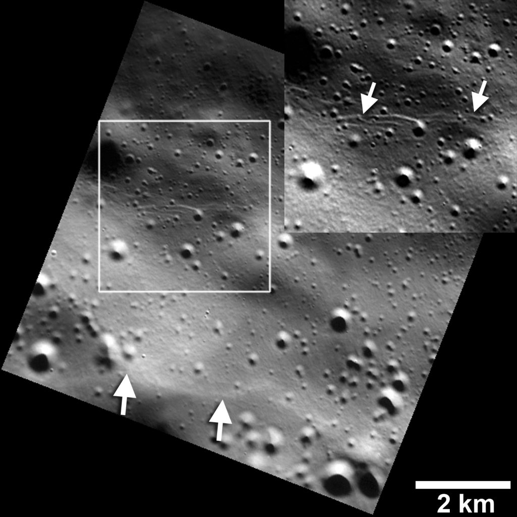 Small graben, or narrow linear troughs, have been found associated with small fault scarps (lower white arrows) on Mercury, and on Earth's moon. The small troughs, only tens of meters wide (inset box and upper white arrows), likely resulted from the bending of the crust as it was uplifted, and must be very young to survive continuous meteoroid bombardment. Photo and caption by NASA/JHUAPL/Carnegie Institution of Washington/Smithsonian Institution