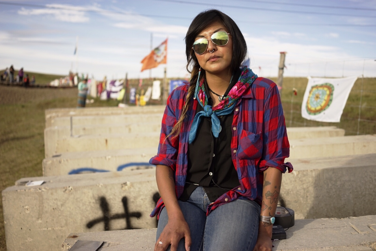 """We aren't people who only exist in the past ... We didn't buy some costumes at the store."" Liz McKenzie is a Dine (Navajo) from New Mexico who had a vivid dream one night about being here at the pipeline protest with the Standing Rock Tribe in North Dakota, woke up, packed up a trailer full of supplies to donate, and drove out. Photo by William Brangham"