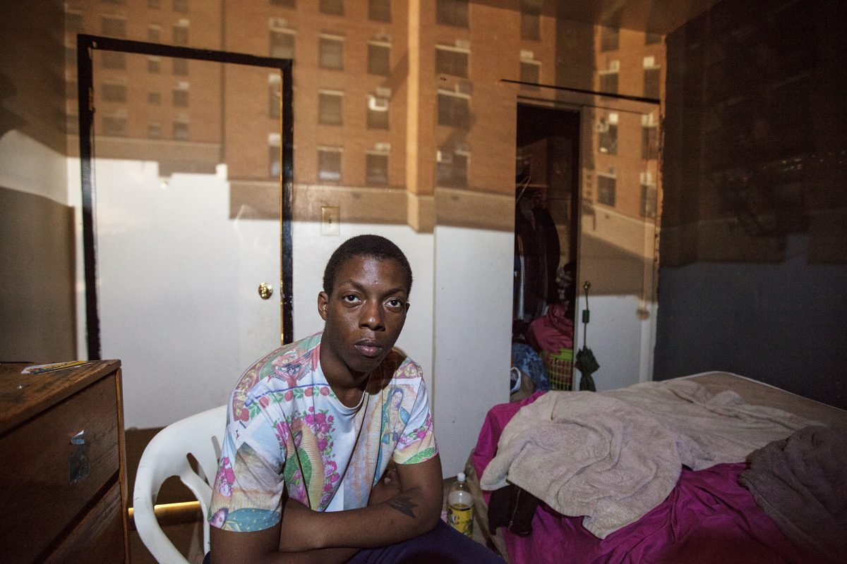 "Esau ""Chubbs"" Johnson, 23, poses for a portrait in East New York, NY on May 30, 2015. ""The cops are cracking down on us. You know, they are shooting kids. That's really what I am worried about: my daughter growing up in that environment."" Photo by Phyllis Dooney"