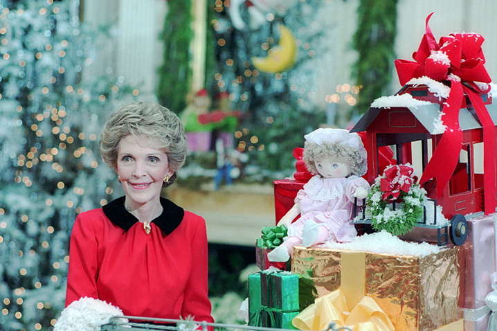 December 8, 1986 - When Mrs. Reagan invites the press to see the Christmas decorations at the White House, reporters question her about unrest in the administration related to the Iran-contra affair. Photo: Reagan Library