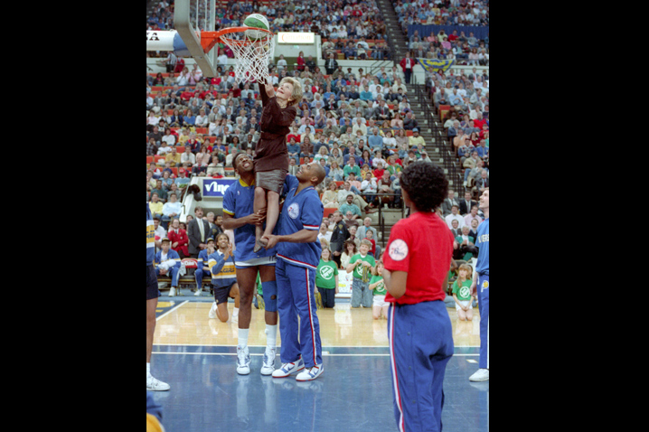 "February 4, 1988 - Charles Barkley and Wayman Tisdale lift Mrs. Reagan up to the basket at a ""Just Say No"" Basketball game in Indianapolis, Indiana. Thousands of anti-drug ""Just Say No"" clubs form at schools around the country. Photo: Reagan Library"