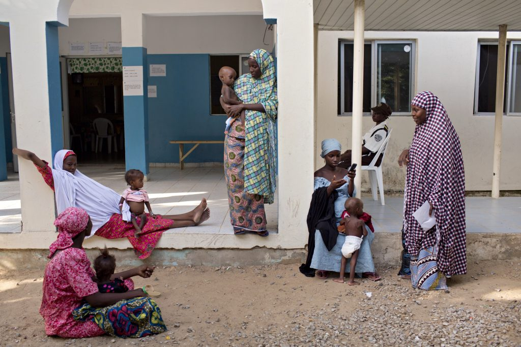 Women talk and exchange numbers outside an IRC-run clinic in Maiduguri. Photo by Danielle Villasana