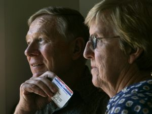 John and Mary Benbow, 67, and 68, respectively, of La Jolla, shown holding his finger over his social security number on his Medicare card, work hard to protect themselves from the scourge of identiy theft. They took their first names off their checks, they black out personal information and shred financial documents before putting them in the trash. There's just one area where they feel vulnerable and there's little that they can do about it. They must carry around their Medicare cards, which are emblazoned with their Social Security numbers, which experts say are a skeleton key to an individual's financial life. (Photo by Allen J. Schaben/Los Angeles Times via Getty Images)