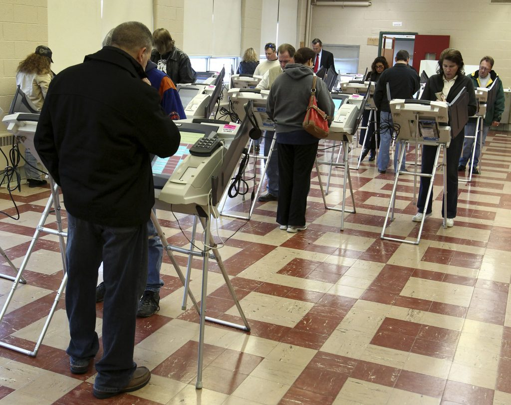 Voters cast their votes using electronic voting machines during the U.S. presidential election at a voting location in Val...