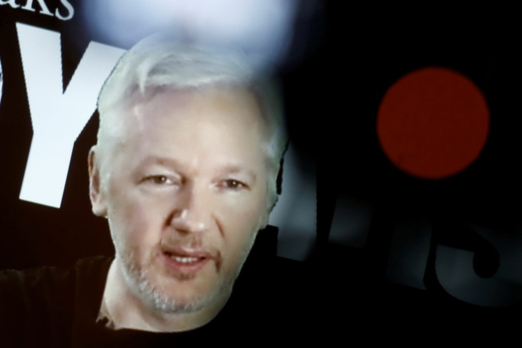 Julian Assange, Founder and Editor-in-Chief of WikiLeaks speaks via video link during a press conference on the occasion o...