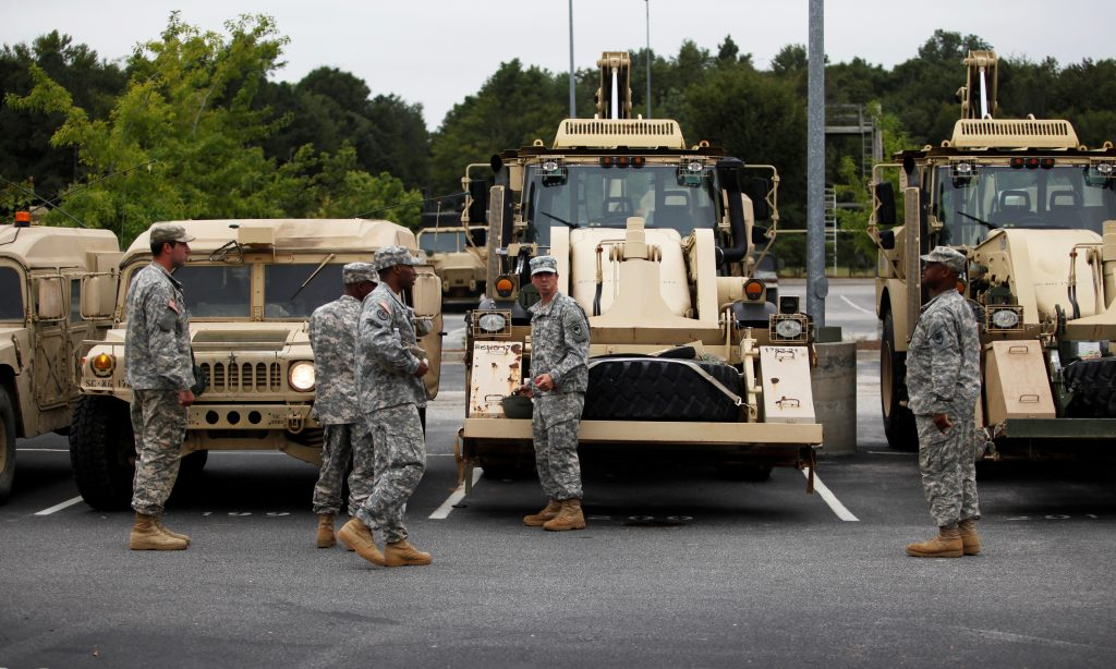 Members of National Guard units 1782 and 172 of Chester and Lancaster, South Carolina, prepare for deployment for Hurricane Matthew service in Conway, South Carolina, U.S. October 6, 2016. REUTERS/Randall Hill