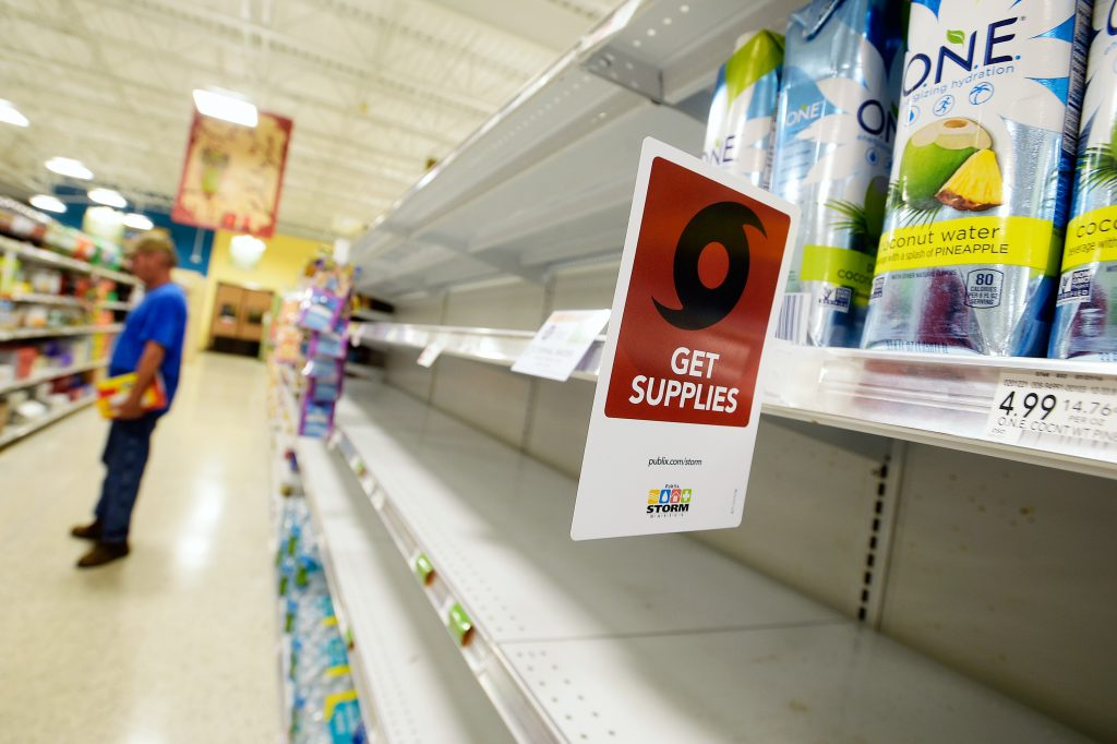 Shelves formerly holding water bottles sit empty at a supermarket before the arrival of Hurricane Matthew in South Daytona, Florida, U.S., Oct. 6, 2016. Photo by Phelan Ebenhack/REUTERS