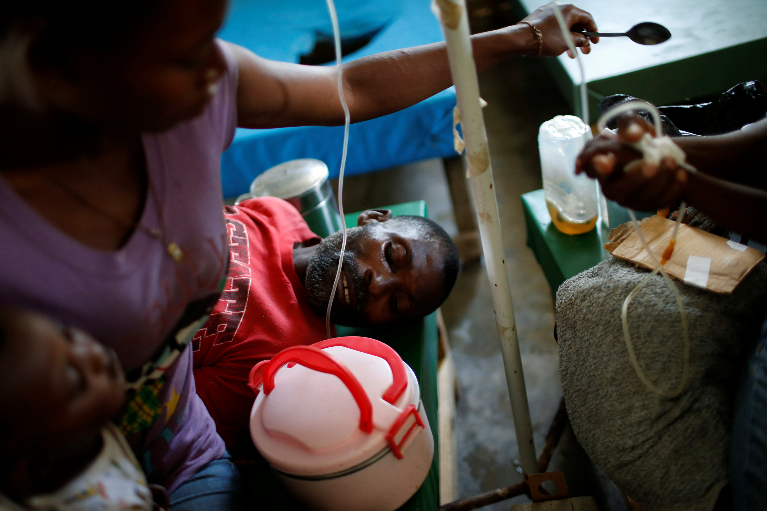 People are treated for cholera at a hospital in Jeremie, Haiti. The International Medical Corps was among the groups warning that cholera cases could spread from the heavy rains and flooding. Photo by Carlos Garcia Rawlins/Reuters