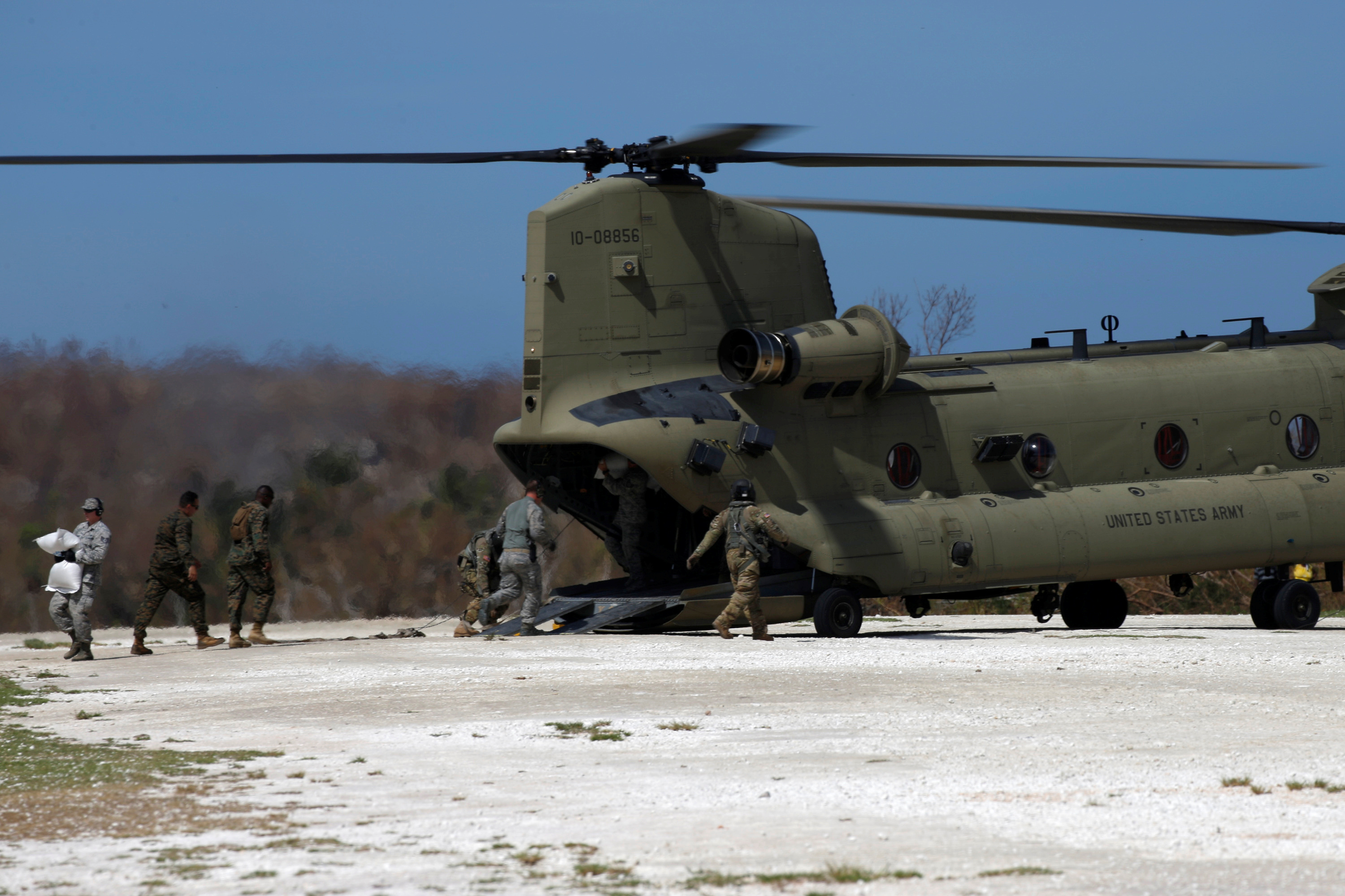 American soldiers deliver aid to parts of Haiti. The most immediate needs were food and clean water. Photo by Carlos Garcia Rawlins/Reuters
