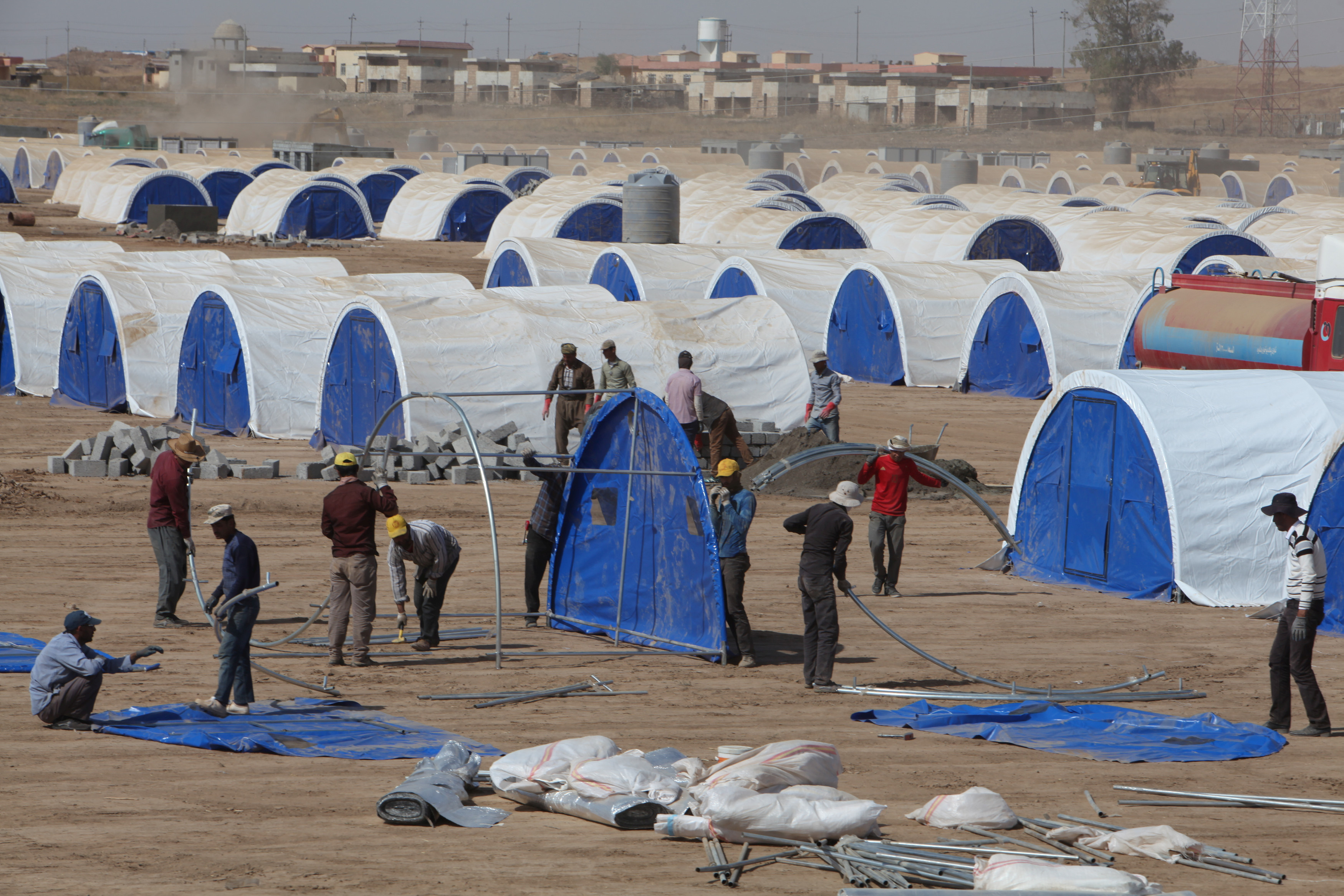 Workers prepare a tent camp in Khazer, west of the Kurdish regional capital Erbil in Iraq, for people fleeing the fighting in Mosul. Photo by Azad Lashkari/Reuters