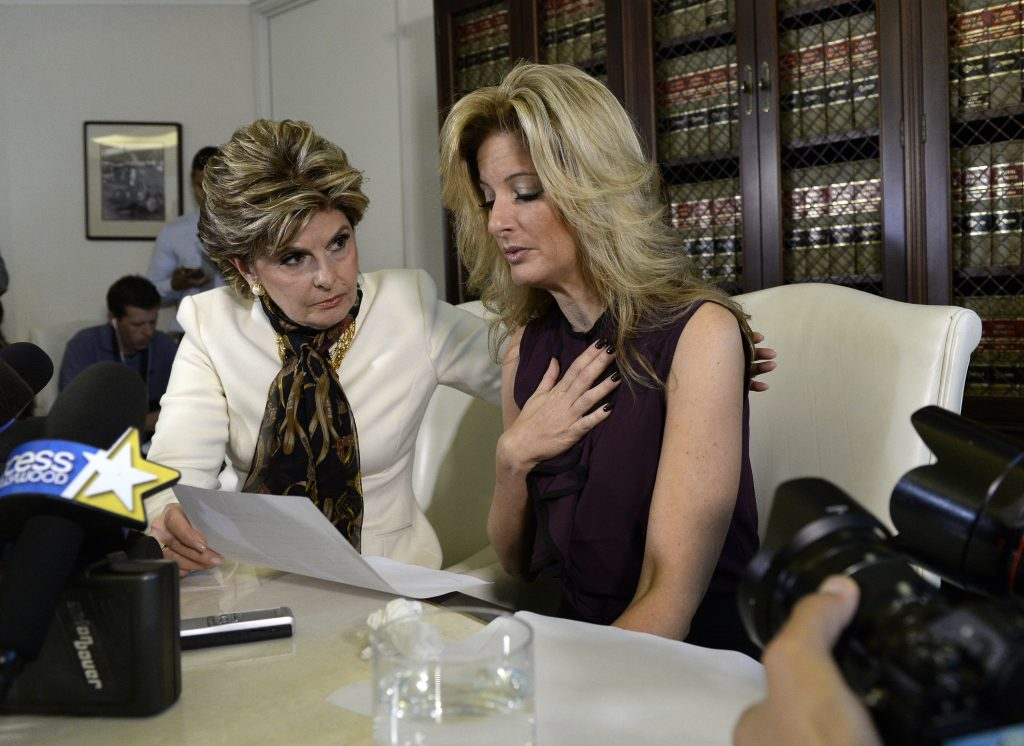 Summer Zervos, a former contestant on the TV show The Apprentice, reacts next to lawyer Gloria Allred (L) while speaking about allegations of sexual misconduct against Donald Trump during a news conference in Los Angeles, California, U.S. October 14, 2016. REUTERS/Kevork Djansezian - RTSSB5F