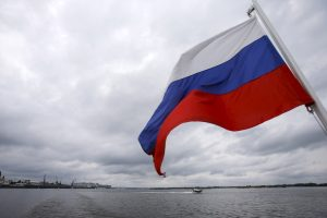 A Russian flag flies over the Volgarive in the town of Nizhny Novgorod, Russia, July 10, 2015. Russia will host the World Cup soccer tournament for FIFA in 2018. REUTERS/Maxim Shemetov - RTX1JXFE