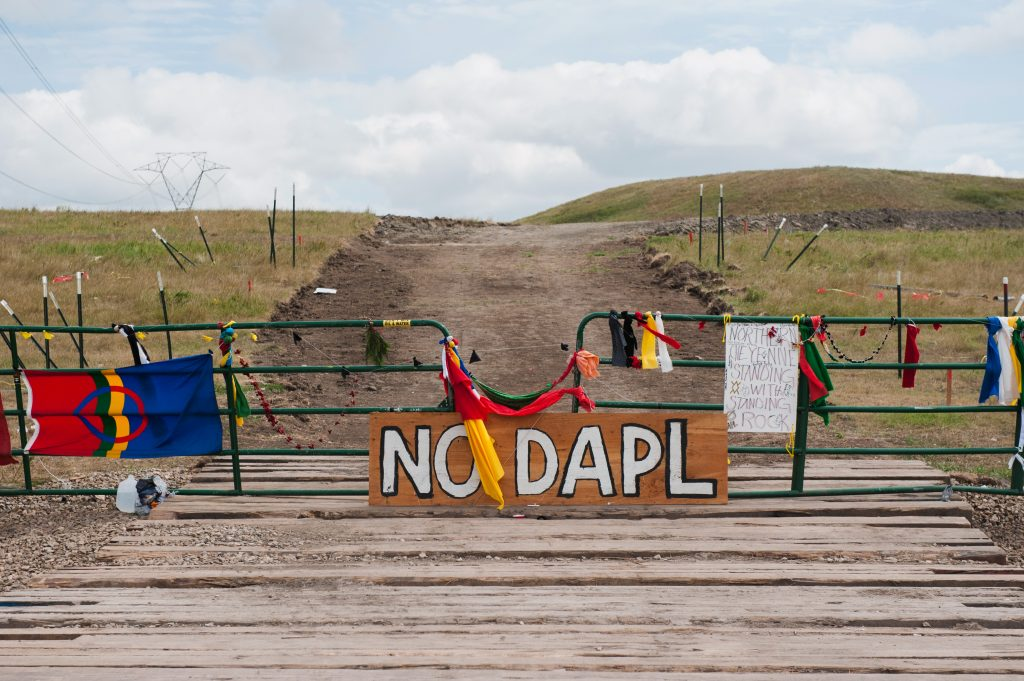 Signs left by protesters demonstrating against the Energy Transfer Partners Dakota Access oil pipeline sit at the gate of a construction access road where construction has been stopped for several weeks due to the protests near the Standing Rock Sioux reservation in Cannon Ball, North Dakota. Photo by Andrew Cullen/Reuters