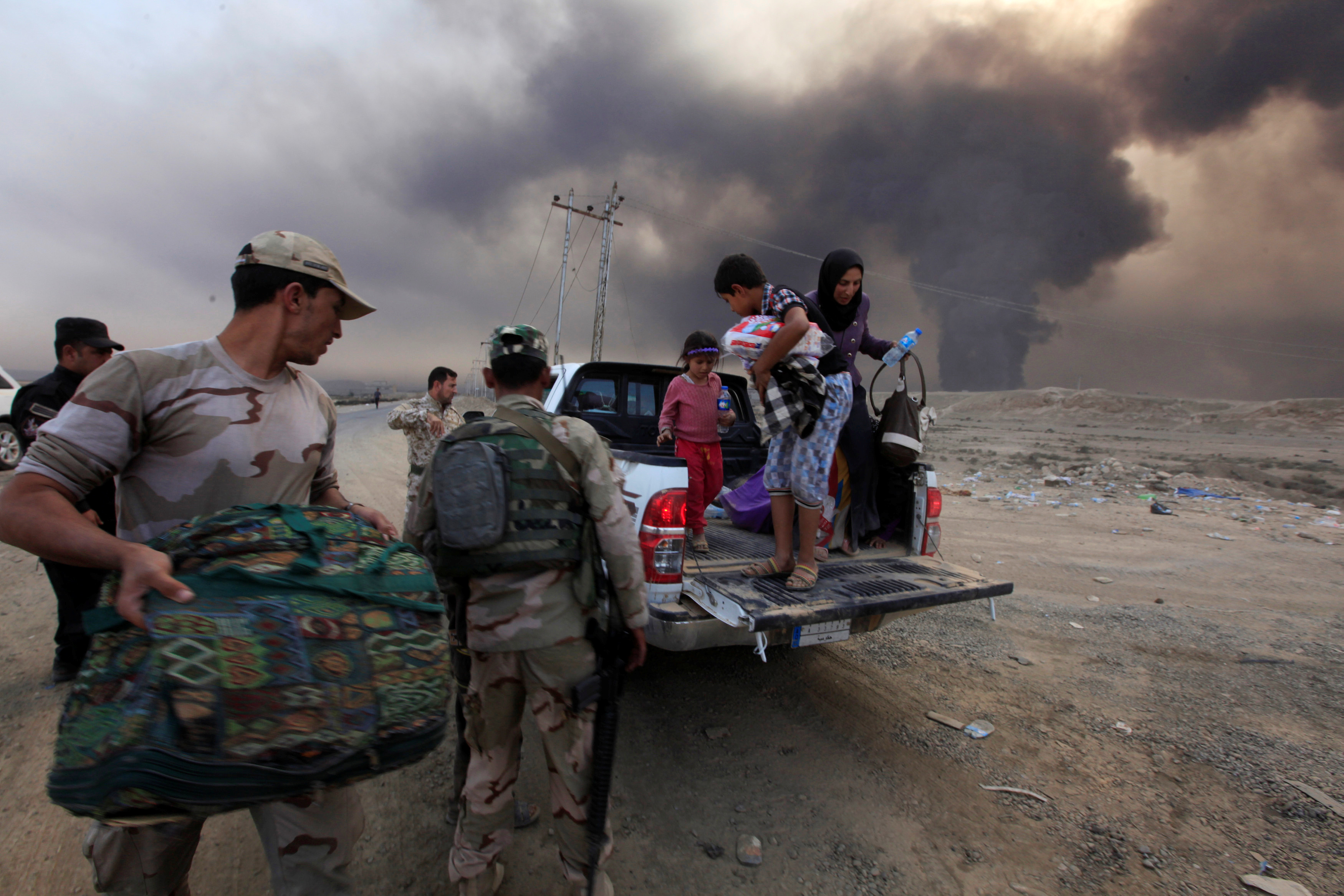 Displaced Iraqis arrive in Qayyarah, south of Mosul, on Oct. 19. About 3.3 million people already are displaced within Iraq, the United Nations said. Photo by Alaa Al-Marjani/Reuters