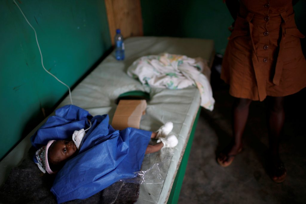 A child is treated for cholera at a hospital in Jeremie in southern Haiti on Oct. 19. Photo by Carlos Garcia Rawlins/Reuters
