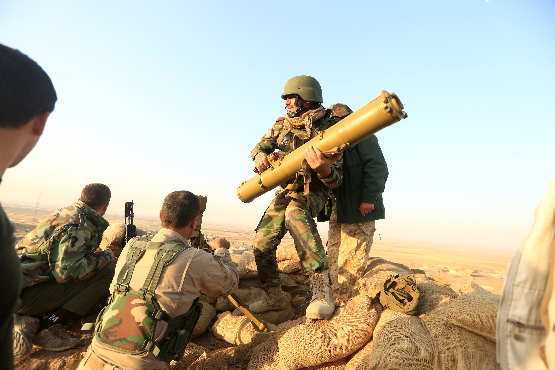 Kurdish peshmerga forces prepare an anti-tank missile targeting Islamic State facilities in the town of Naweran near Mosul, Iraq. Photo by Zohra Bensemra/Reuters