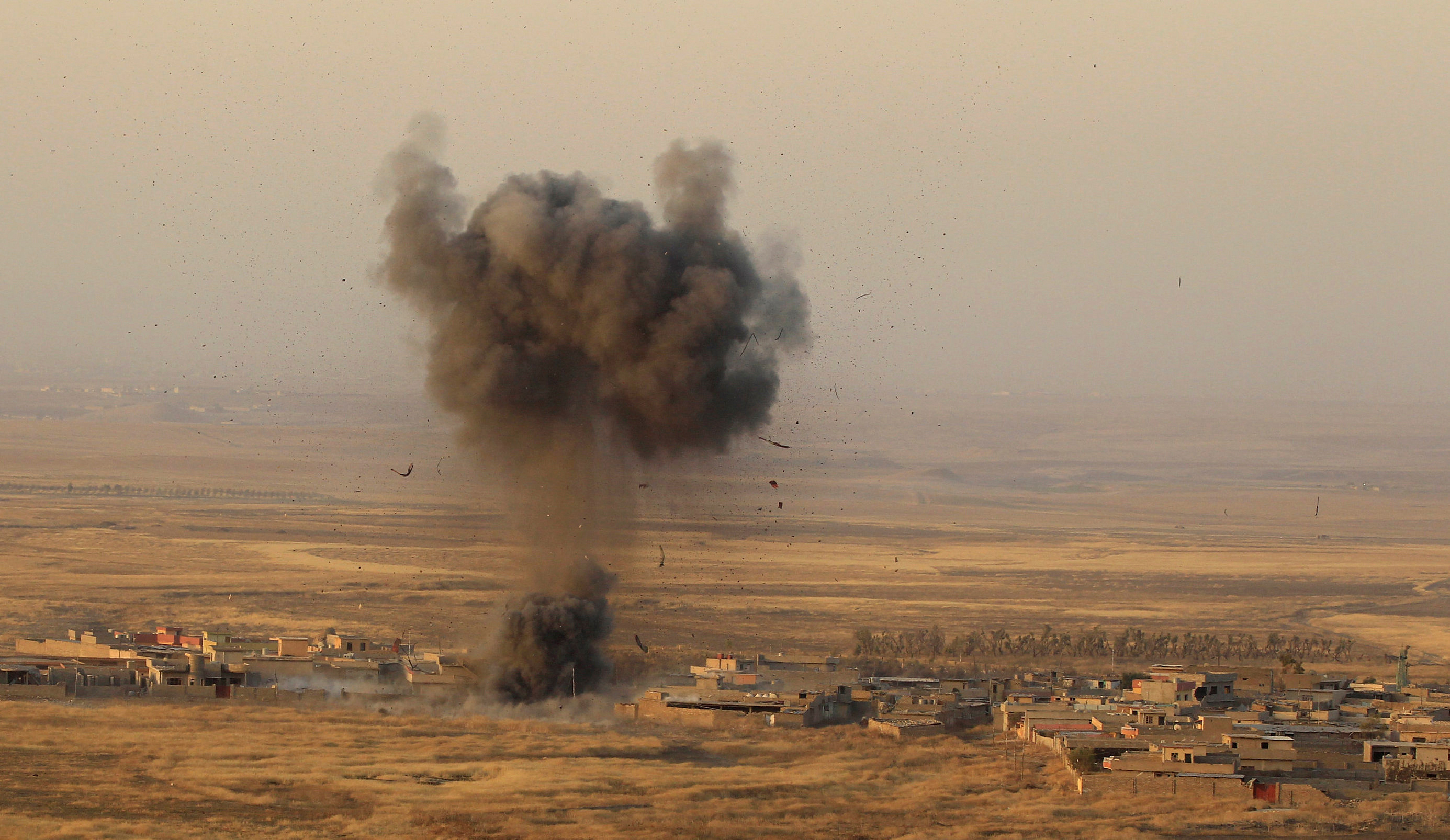 A bomb hits an Islamic State militant position in the town of Naweran near Mosul, Iraq on Oct. 20. The Pentagon says Mosul liberation could take some time but that Iraqis have the capabilities to do it. Photo by Zohra Bensemra/Reuters