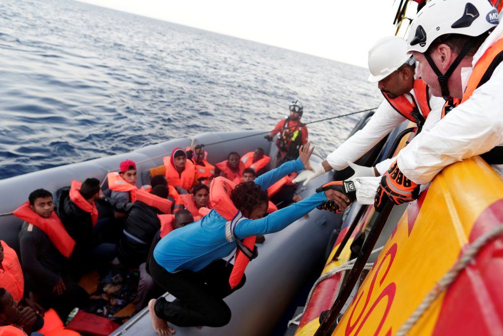 Migrants are seen during rescue operation in the Mediterranea Sea on Oct. 20, 2016. Photo by Yara Nardi/Italian Red Cross press office via Reuters