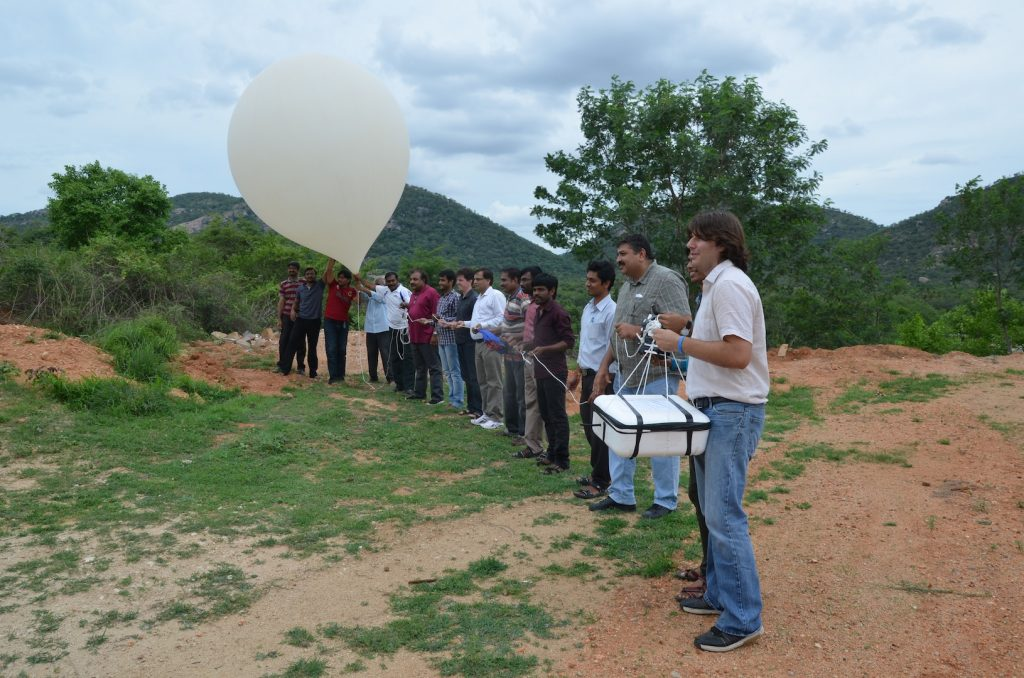NASA Langley's Jean-Paul Vernier, right, holds a package of instruments about to be launched on a weather balloon into the skies over southeast India. Vernier and colleague Tobias Wegner traveled to Gadanki, India, to study an atmospheric feature called the Asian Tropopause Aerosol Layer or ATAL. Photo by NASA