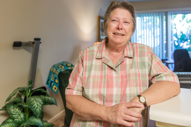 Lee Marquardt, 74, at the Triangle Square Apartments in Los Angeles, California, on August 16, 2016.  Marquardt moved into the apartment building two years ago. She said she didn't want to spend her elder years hiding her true self as she had as a younger woman. (Heidi de Marco/KHN)