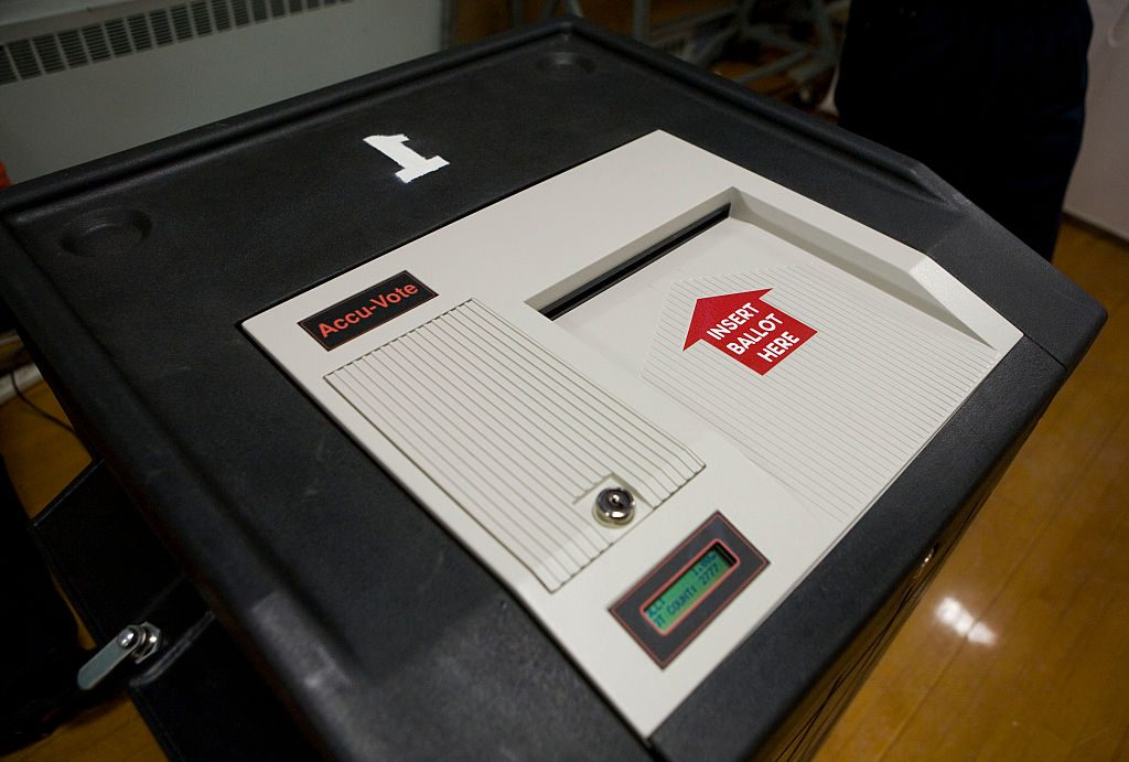 An electronic scanning machine is used for counting the votes during the New Hampshire primary election at a high school in Nashua, New Hampshire. Photo by Ramin Talaie/Corbis via Getty Images