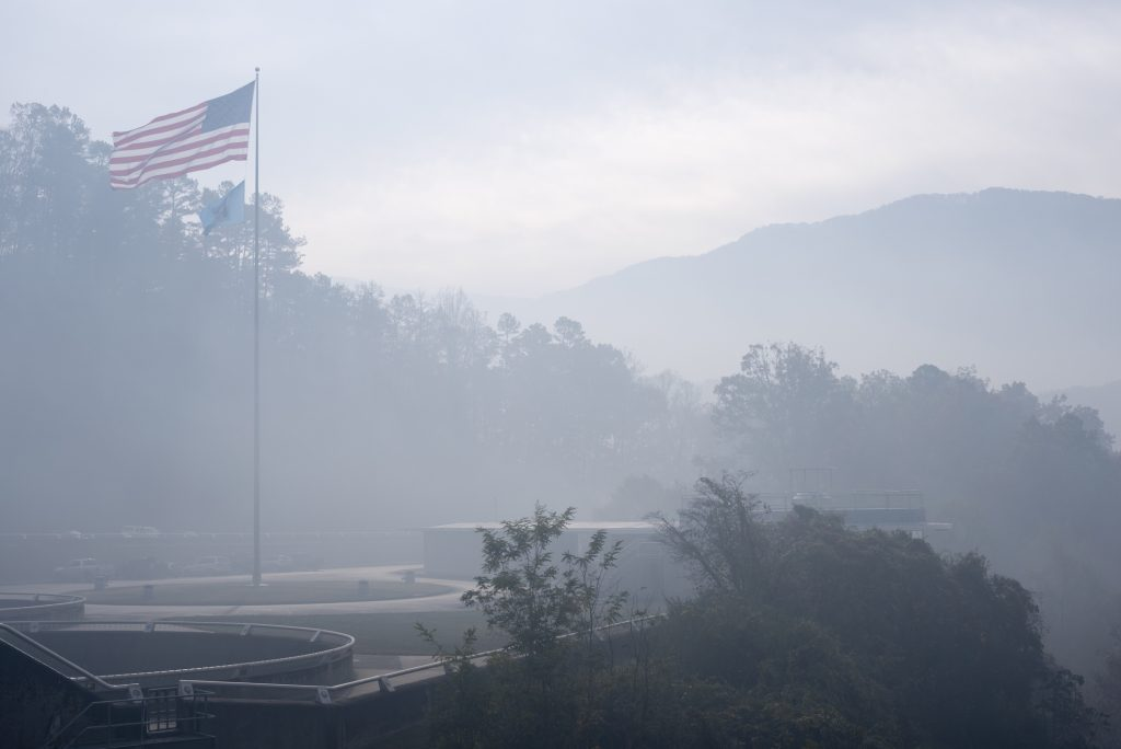 Smoke from forest fires obscures the view at the Fontana Dam Visitors Center, located at the base of the Great Smoky Mountains National Park in western North Carolina on November 11, 2016. Photo by Joel Carillet