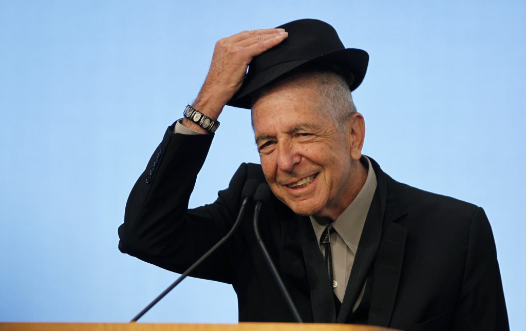 Musician Leonard Cohen tips his hat to the audience as he accepts the 2012 Awards for Song Lyrics of Literary Excellence, which was awarded to both he and Chuck Berry at the John F. Kennedy Presidential Library and Museum, in Boston, Massachusetts February 26, 2012 REUTERS/Jessica Rinaldi (UNITED STATES - Tags: ENTERTAINMENT) - RTR2YHQ8
