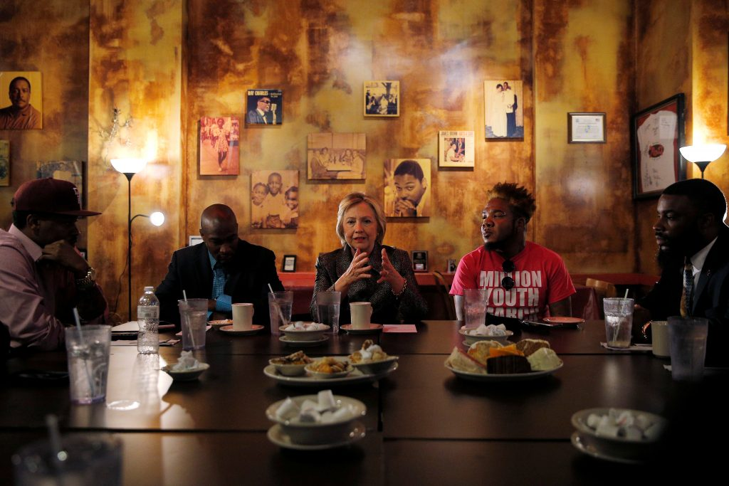 Democratic presidential nominee Hillary Clinton meets with leaders from the African-American community at Mert's Heart and Soul restaurant in Charlotte, North Carolina. Photo by Brian Snyder/Reuters