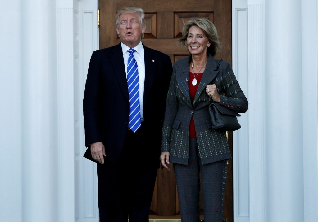 Donald Trump stands with Betsy DeVos after their meeting at the main clubhouse at Trump National Golf Club in Bedminster, New Jersey in November. Photo by Mike Segar/Reuters