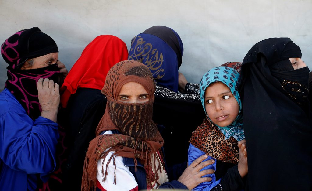 Women wait for food on the outskirts of Mosul, Iraq on Nov. 20, 2016. Photo by Goran Tomasevic/Reuters