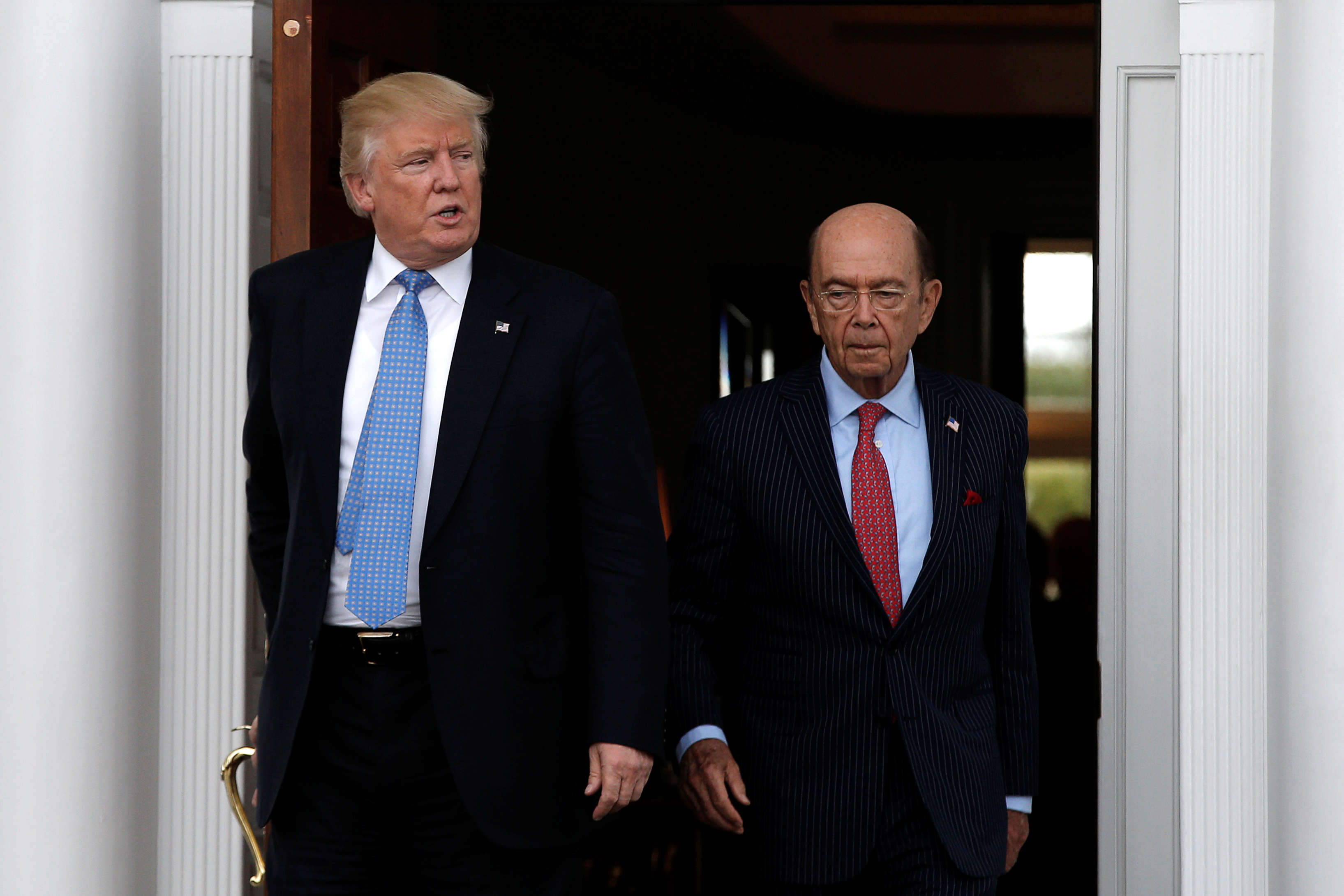 U.S. President-elect Donald Trump emerges with Wilbur Ross after their meeting at Trump National Golf Club in Bedminster, New Jersey, U.S., November 20, 2016.  REUTERS/Mike Segar - RTSSISN