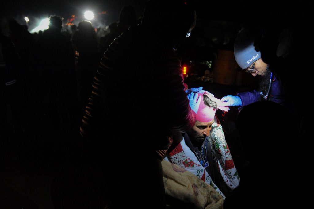 A protester is given medical attention during a protest against plans to pass the Dakota Access pipeline near the Standing Rock Indian Reservation, near Cannon Ball, North Dakota. Photo by Stephanie Keith/Reuters