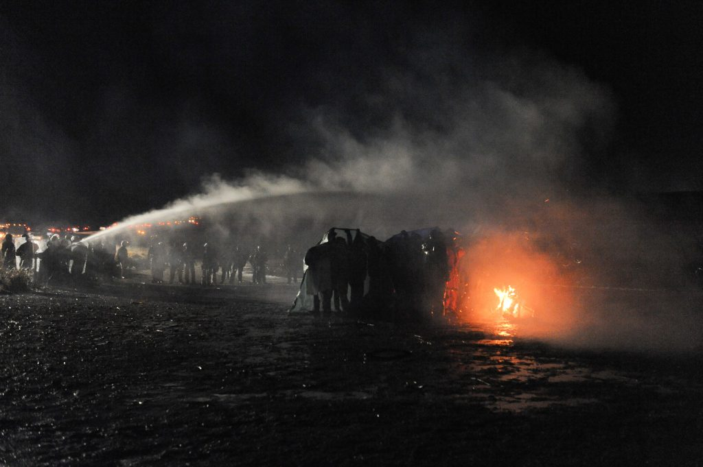Police deploy water hoses, tear gas against Standing Rock protesters