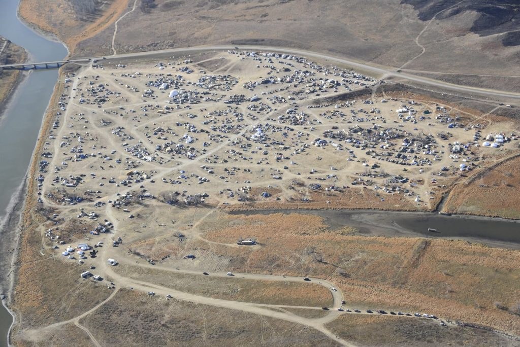 Dakota Access Pipeline protesters are seen at the Oceti Sakowin campground near the town of Cannon Ball, North Dakota in an aerial photo provided by the Morton County Sheriff's Department. Photo handout via Reuters.