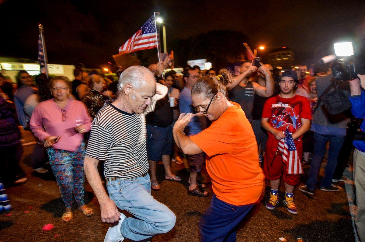 Cubans in Miami celebrate the death of Cuban leader Fidel Castro in Little Havana, Miami, Florida, U.S. November 26, 2016.  REUTERS/Gaston De Cardenas - RTSTD8R