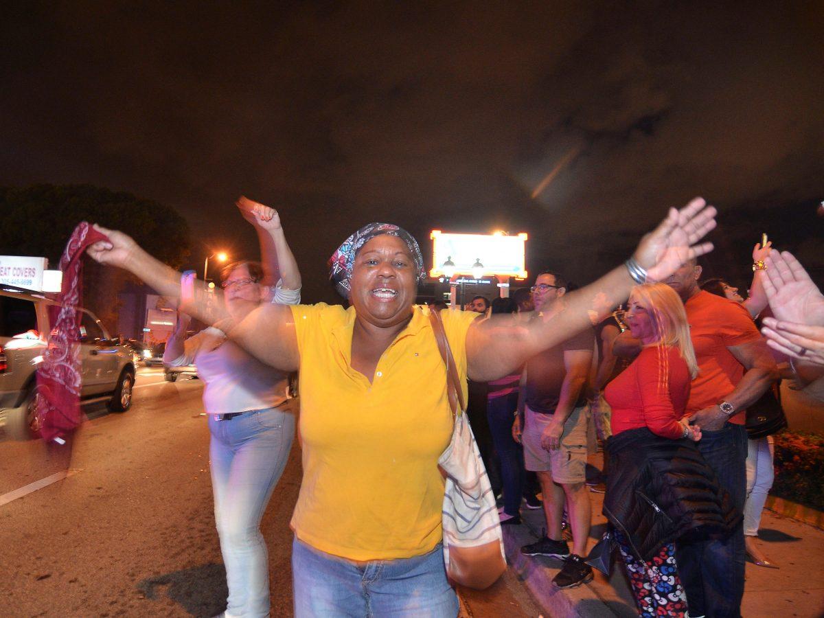 People celebrate the death of Cuban leader Fidel Castro, in Little Havana, Miami, Florida, U.S. November 26, 2016.  REUTERS/Gaston De Cardenas  - RTSTDBJ
