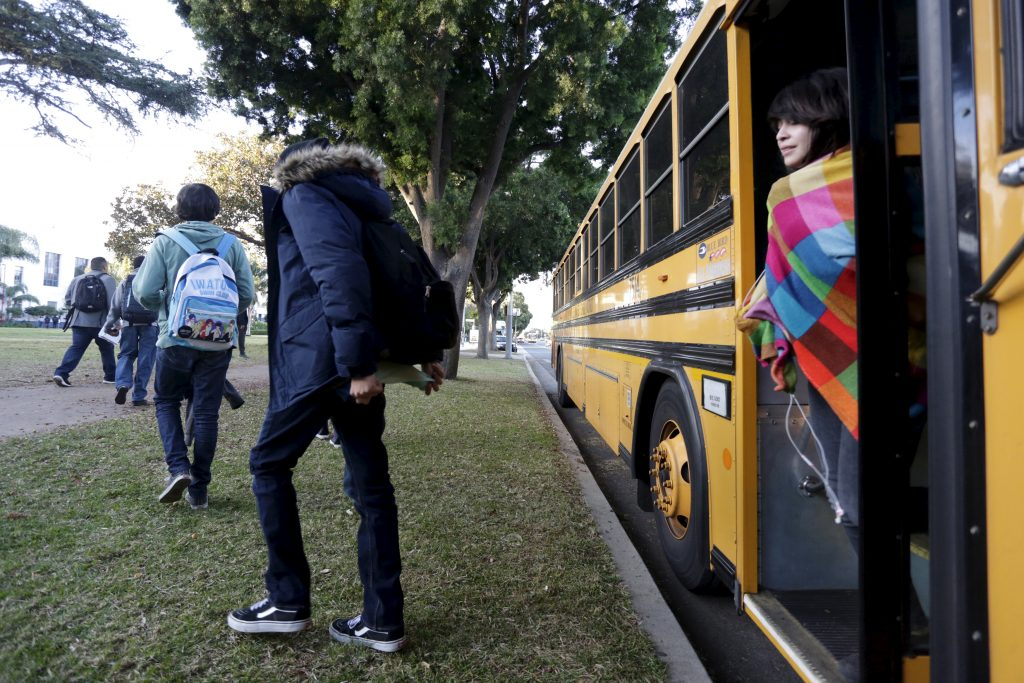 Students exit a bus in Los Angeles. File photo by Jonathan Alcorn/Reuters