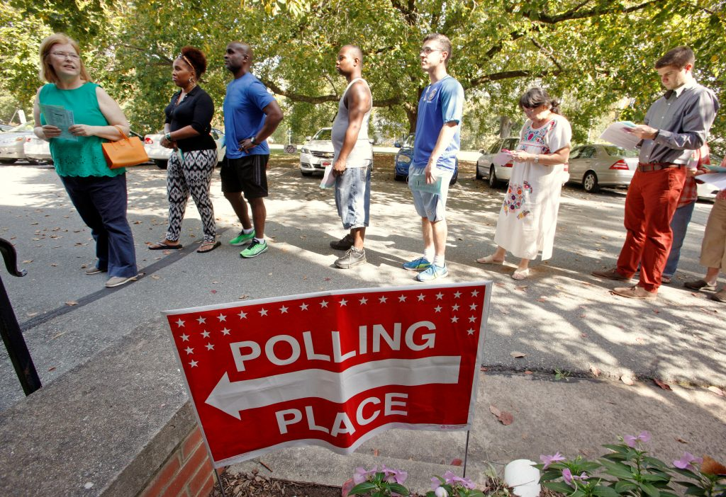 People arrive to cast their ballot for 2016 elections at a polling station as early voting begins in North Carolina, in Carrboro, North Carolina, U.S., October 20, 2016. REUTERS/Jonathan Drake - RTX2PR63