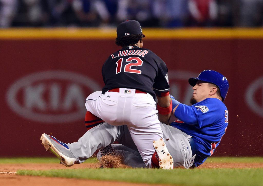 Nov 2, 2016; Cleveland, OH, USA; Chicago Cubs player Kyle Schwarber (in blue) is tagged out by Cleveland Indians shortstop Francisco Lindor while trying to stretch a single into a double in the third inning in game seven of the 2016 World Series at Progressive Field. Photo by Ken Blaze/USA TODAY Sports