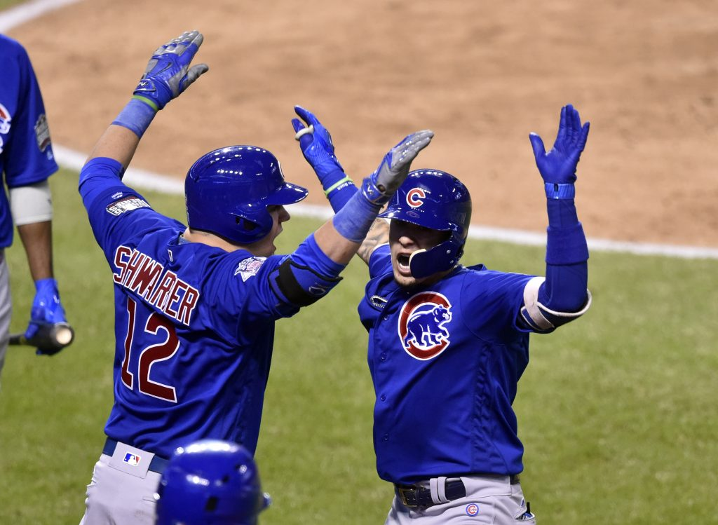 Chicago Cubs second baseman Javier Baez (right) celebrates with player Kyle Schwarber (12) after a solo home run against the Cleveland Indians in the fifth inning in game seven of the 2016 World Series at Progressive Field. Photo by David Richard/USA TODAY Sports