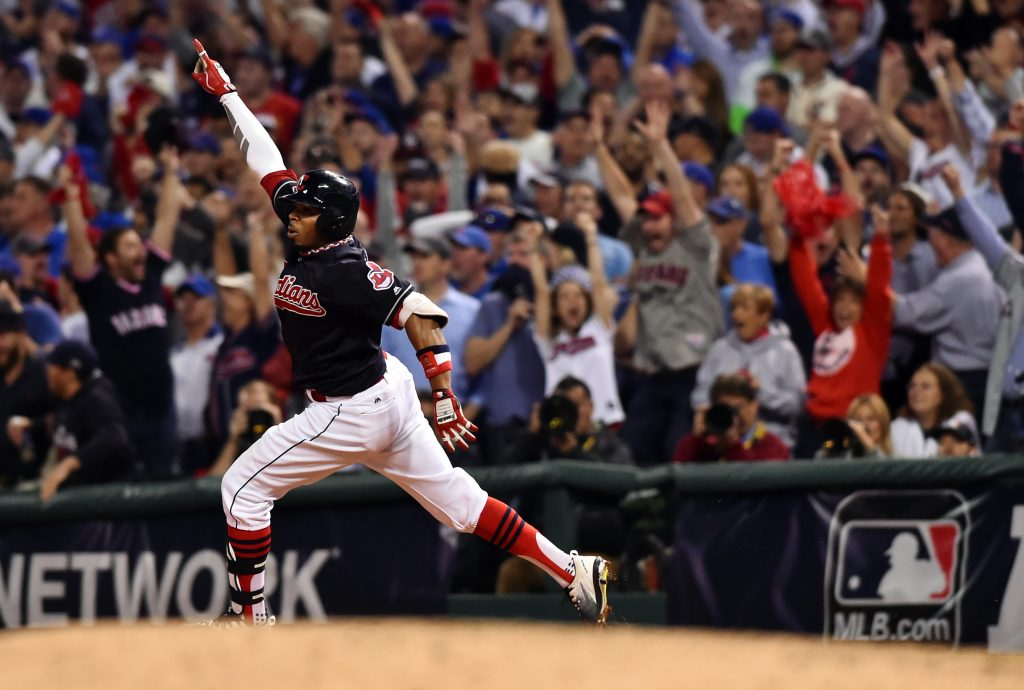 Cleveland Indians center fielder Rajai Davis (20) celebrates after hitting a two-run home run against the Chicago Cubs in the 8th inning in game seven of the 2016 World Series at Progressive Field. Photo by Ken Blaze/USA TODAY Sports