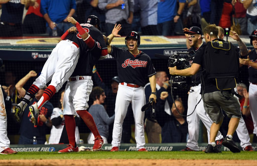 Cleveland Indians center fielder Rajai Davis (20) celebrates with teammates after hitting a two-run home run against the Chicago Cubs in the 8th inning in game seven of the 2016 World Series at Progressive Field. Photo by Tommy Gilligan/USA TODAY Sports