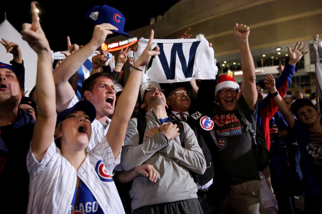 Fans of National League baseball team Chicago Cubs celebrate their Major League Baseball World Series Game 7 victory against American League's Cleveland Indians outside Progressive Field in Cleveland, Ohio. Photo by Shannon Stapleton/Reuters