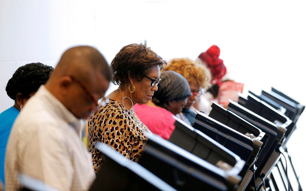 Voters cast their ballots during early voting at the Beatties Ford Library in Charlotte, North Carolina, U.S. on October 20, 2016. To match Insight USA-ELECTION/NORTHCAROLINA REUTERS/Chris Keane/File Photo - RTX2ROEQ