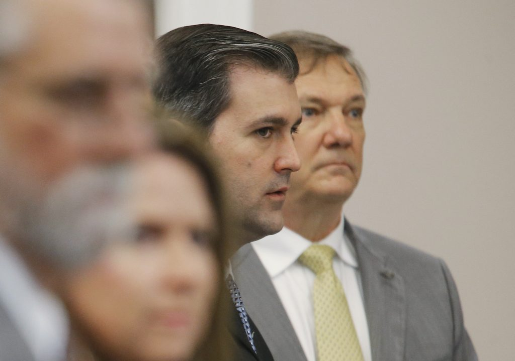 Former North Charleston police officer Michael Slager, 34, standing trial on a murder charge in the April 2015 shooting death of 50-year-old Walter Scott, stands in the courtroom in Charleston, South Carolina. Photo by Grace Beahm/Reuters