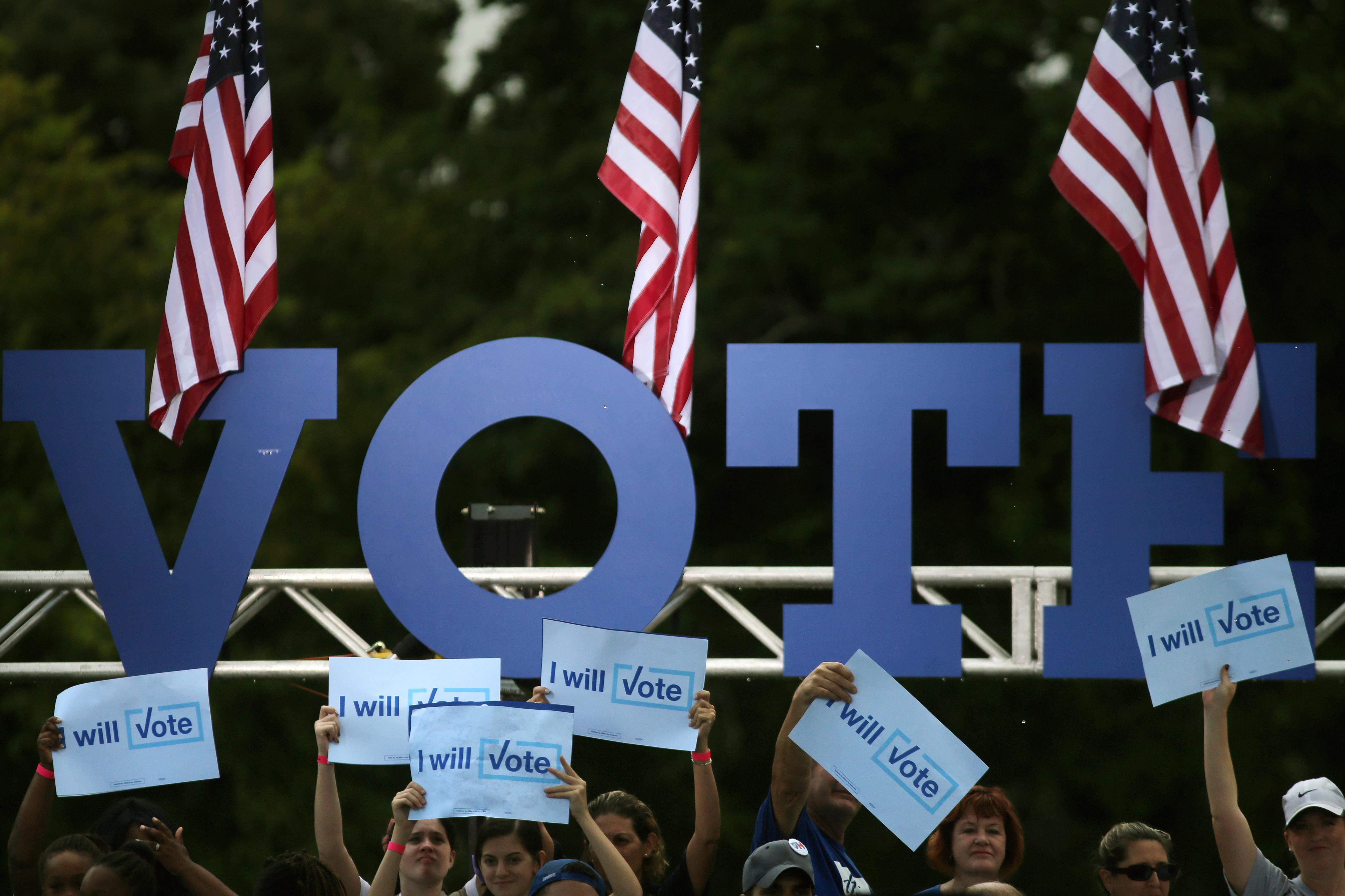 Supporters hold campaign signs as they wait for the arrival of U.S. Democratic presidential nominee Hillary Clinton during a rally in Pembroke Pines, Florida U.S., November 5, 2016. REUTERS/Carlos Barria - RTX2S2N9